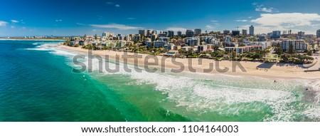 Aerial panoramic image of ocean waves on a Kings beach, Caloundra, Queensland, Australia