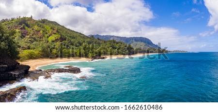 Aerial panoramic image off the coast over Lumaha'i beach on Hawaiian island of Kauai with Na Pali mountains behind Stock photo ©