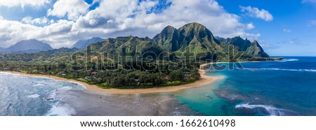 Aerial panoramic image off the coast over Tunnels beach on Hawaiian island of Kauai with Na Pali mountains behind Stock photo ©