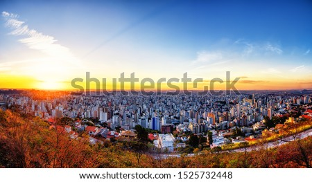 Aerial Panoramic Landscape of Belo Horizonte City seen from Water Tank Gazebo (Mirante da Caixa D'Água) During a Colorful Sunset, Located in Minas Gerais State, Brazil #1525732448