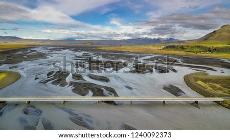 Aerial panoramic landscape view of a bridge and the riverbed beneath in Iceland