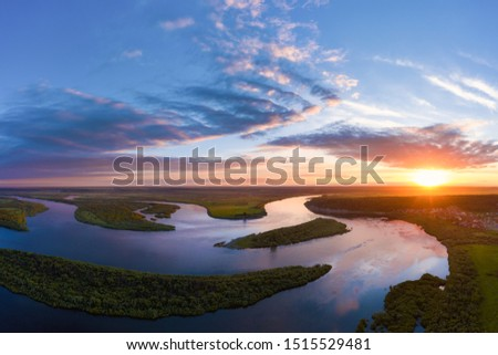 Aerial panoramic landscape with sunset over the river with islands and beautiful clouds on the sky. #1515529481