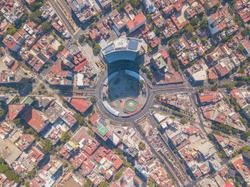 Aerial panoramic top view of the famous insurgents roundabout surrounded by buildings and houses, giant highway junction of mexico city