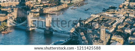 Aerial panoramic view from above of London city and the River Thames, England, United Kingdom UK. Europe cityscape travel destination. Banner crop.