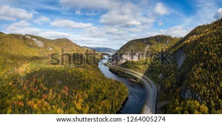 Aerial panoramic view of a scenic road during a vibrant sunny day. Taken near Corner Brook, Newfoundland, Canada. #1264005274