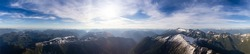 Aerial Panoramic View of Beautiful Canadian Mountain Landscape during a sunny and cloudy day. Taken near Squamish and Vancouver, British Columbia, Canada. Nature Background Panorama