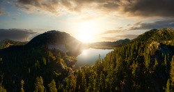 Aerial Panoramic View of Beautiful Glacier Lake in the Canadian Mountain Landscape. Dramatic Colorful Sunset Art Render. Whistler, British Columbia, Canada. Nature Background Panorama