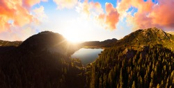 Aerial Panoramic View of Beautiful Glacier Lake in the Canadian Mountain Landscape. Dramatic Sunset Sky Art Render. Whistler, British Columbia, Canada. Nature Background Panorama