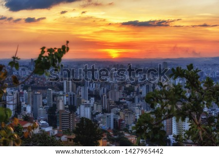 Aerial Panoramic View Of Beautiful Orange Sky during Sunset over Belo Horizonte City seen from Water Tank Belvedere (Mirante da Caixa D'Água)