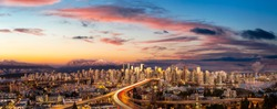 Aerial Panoramic view of Downtown Vancouver, Cambie Bridge, and False Creek. Picture taken during a cloudy sunset. Colorful sky Overlay.