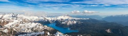 Aerial Panoramic View of Garibaldi surrounded by Beautiful Canadian Mountain Landscape during a sunny and cloudy day. Taken near Squamish and Whistler, North of Vancouver, British Columbia, Canada.