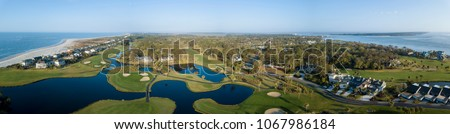 Aerial panoramic view of golf course and houses on Fripp Island, South Carolina #1067986184