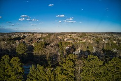 Aerial panoramic view of house cluster in a sub division in Suburbs   in metro Atlanta in Georgia ,USA shot by drone shot during golden hour
