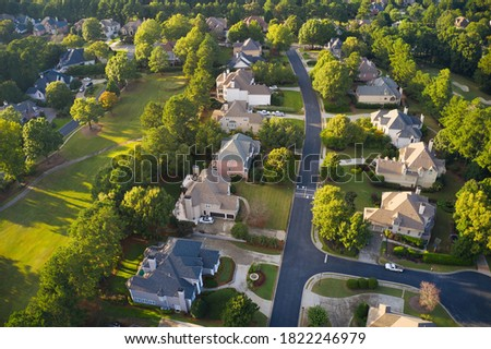 Aerial panoramic view of house cluster in a sub division in Suburbs  with golf course and lake in metro Atlanta in Georgia ,USA shot by drone shot during golden hour ストックフォト ©