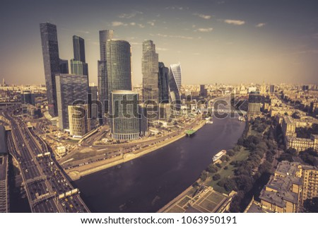 Aerial panoramic view of Moscow in summer, Russia. Moscow skyline. Panorama of the city with Moskva River. Vintage photo of Moscow. Modern skyscrapers in Moscow.