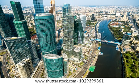 Aerial panoramic view of Moscow with Moskva River in summer, Russia. Panorama of Moscow in the sunlight. Modern skyscrapers of Moscow-City. Landscape and cityscape of Moscow. The city from above. #1029399361