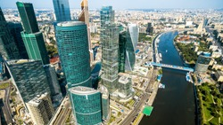 Aerial panoramic view of Moscow with Moskva River, Russia. Cityscape of Moscow with business skyscrapers of Moscow-City. The look of the city from above. Panorama of the modern buildings of Moscow.