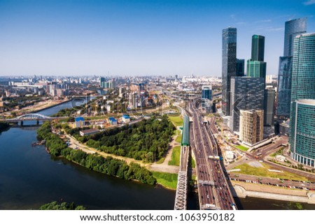 Aerial panoramic view of Moscow with Moskva River, Russia. Moscow skyline in summer. Business skyscrapers of Moscow-City in the right. Cityscape of Moscow with the TTK road and bridge from above.