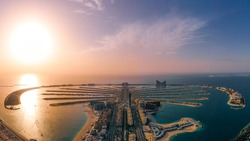 Aerial panoramic view of Palm Jumeirah during sunset; Man made palm shaped island in Dubai, UAE