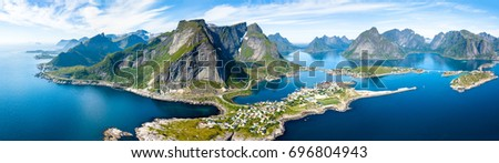 Photo of  Aerial panoramic view of Reine traditional fishing village in the Lofoten archipelago in northen Norway with blue sea and mountains during sunny arctic summer