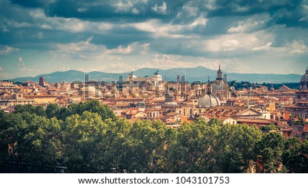 Aerial panoramic view of Rome, Italy. Cityscape of old Rome on a sunny day. Rome skyline in summer. Beautiful scenic panorama of Rome from above. The vintage picturesque photo of Roma city.
