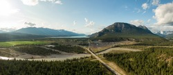 Aerial Panoramic View of Small Town, Canal Flats, during a sunny and cloudy summer day. Located in the Kootenay, British Columbia, Canada.