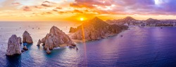 Aerial panoramic view of the Cabo San Lucas, Mexico marina and the rock formations at Lands End. the southernmost tip of the Baja California peninsula, where the Sea of Cortez meets the Pacific Ocean