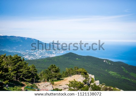 Aerial panoramic view of the city of Yalta in Crimea, Russia. Ayu-Dag or Bear Mountain in the background. Landscape of the South coast of Crimea