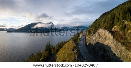 Aerial panoramic view of the Sea to Sky Highway in Howe Sound during a vibrant sunny day. Taken North of Vancouver, British Columbia, Canada. #1043290489
