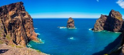 Aerial panoramic view of the seascape and mountain cliffs in Ponta de Sao shore in Madeira island, Portugal