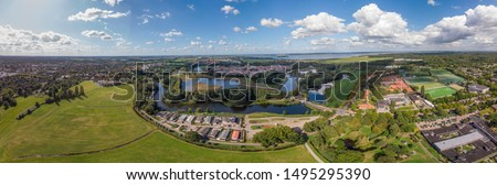 Aerial 360 panoramic view on the fortification city Naarden Vesting below a cloud with its defensive constructions surrounding the village against a blue sky with clouds passing #1495295390