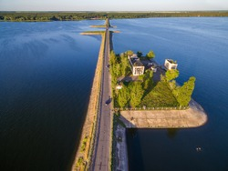 Aerial panoramic view to old abandoned pumping station building on dam at Severskiy Donets river, Pechenegi reservoir,  Ukraine