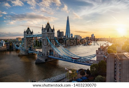Aerial panoramic view to the iconic Tower Bridge and skyline of London, UK, during sunset time