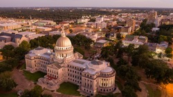Aerial Perspective as night falls over the buildings and streets of Jackson Mississippi