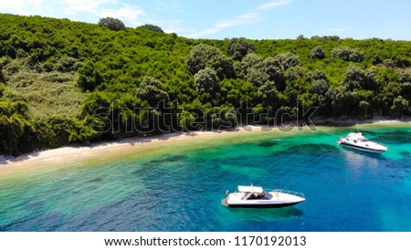 Aerial perspective of a hidden blue tropical cove dotted with local pleasure-craft #1170192013