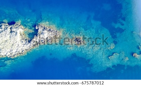 aerial photo above rock reef...