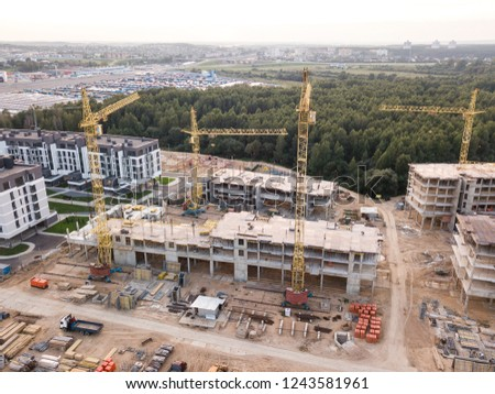 aerial photo construction of houses and buildings, drone photo of construction site. tower cranes and industrial machinery for building construction