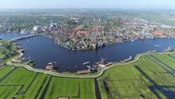 Aerial photo from helicopter showing Zaandam is a city in province of North Holland Netherlands and located on the river Zaan near Amsterdam known for the Zaanse Schans historic windmills