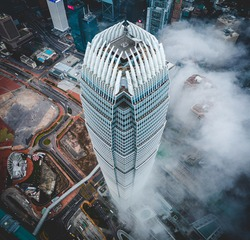 Aerial photo in Hong Kong skyline in Spring, with sea of clouds. IFC. International Finance Corporation