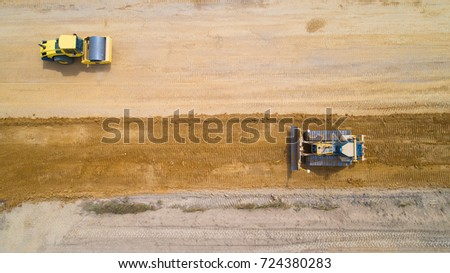 Aerial photo of a steam roller and a bulldozer on a construction site in Rouans, Loire Atlantique