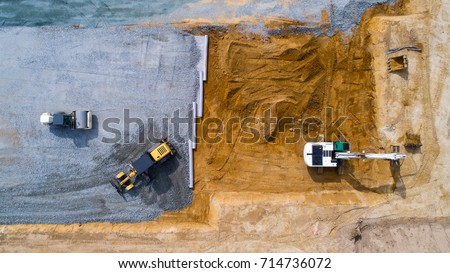Aerial photo of an excavator and bulldozers working on a construction site in Treillieres, Loire Atlantique, France