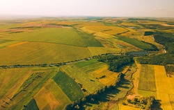 Aerial photo of beautiful landscape with some agriculture crops wheat and sunflowers.