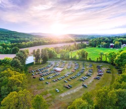 Aerial photo of beautiful outdoor country drive-in movie theater at sunset. Taken at Northfield Drive-In Theater.