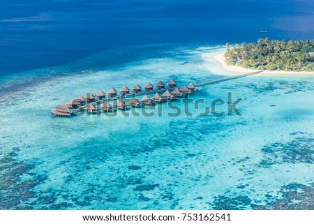 Aerial photo of beautiful paradise Maldives tropical beach on island. Summer and holiday and travel vacation concept design
