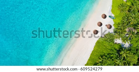 Stock Photo Aerial photo of beautiful paradise Maldives tropical beach on island. Summer and travel vacation concept.