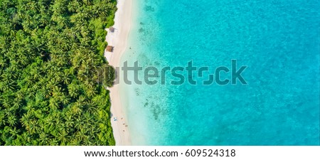 Aerial photo of beautiful paradise Maldives tropical beach on island. Summer and travel vacation concept. #609524318