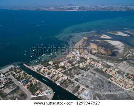 Aerial photo of buildings, villas and the beach on a natural spit of La Manga between the Mediterranean and the Mar Menor, Cartagena, Costa Blanca, Spain. 19