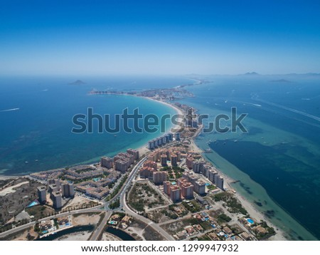 Aerial photo of buildings, villas and the beach on a natural spit of La Manga between the Mediterranean and the Mar Menor, Cartagena, Costa Blanca, Spain. 17