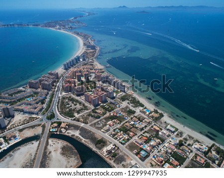 Aerial photo of buildings, villas and the beach on a natural spit of La Manga between the Mediterranean and the Mar Menor, Cartagena, Costa Blanca, Spain. 18