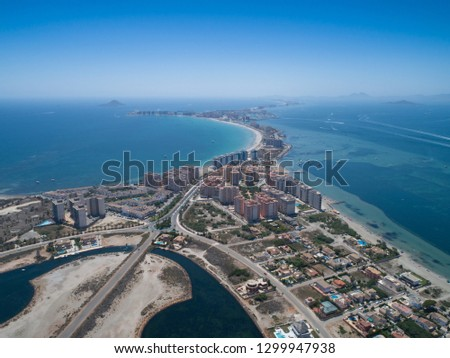 Aerial photo of buildings, villas and the beach on a natural spit of La Manga between the Mediterranean and the Mar Menor, Cartagena, Costa Blanca, Spain. 16